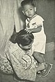 Woman dressing her son for the first day of school, Wanita di Indonesia p43 (Ministry of Information).jpg