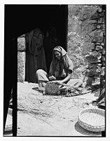 Woman weaving reed baskets. LOC matpc.04633.jpg
