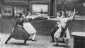 Women fencers - attacking and parrying, second position in sword exercise.png