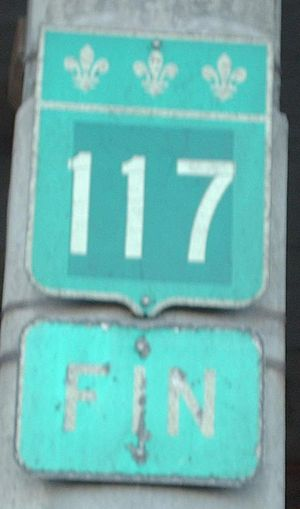"Quebec Route 117 - 117 Fin/End sign at the end of Marcel Laurin Blvd. in Montreal, Quebec.  As of 2008, the ""117"" signage has been stolen, leaving only the ""FIN"" signage."