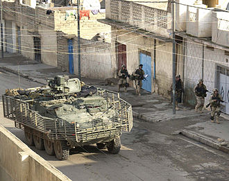 Mechanized infantry - Stryker vehicle and dismounted infantry of the US Army's 1st Brigade Combat Team in Mosul, Iraq 2004.