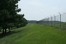 fence meaning. Typical Perimeter Fence With Barbed Wire On Top. Meaning N