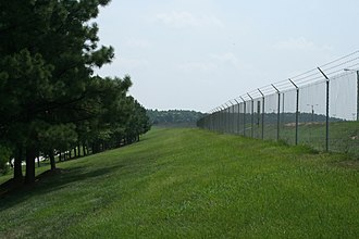 Typical chain link perimeter fence with barbed wire on top 2008-07-30 Fence along Commerce Blvd at RDU.jpg