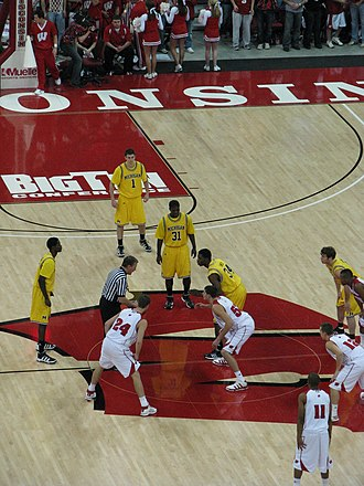 2009–10 Wisconsin Badgers men's basketball team - DeShawn Sims of Michigan and Keaton Nankivil prepare for the opening tipoff. (2010-01-20)