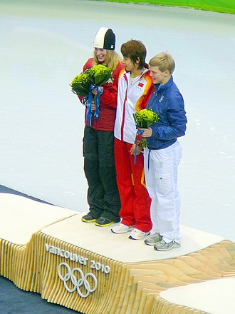 China at the 2010 Winter Olympics - Wang Meng (centre) at the medal presentation for the 500 metres.