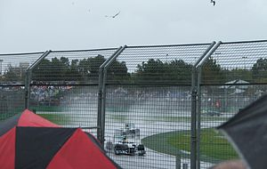 2013 Australian Grand Prix - New Mercedes teammates, Hamilton and Rosberg, negotiating turn 2 during a waterlogged qualifying session.