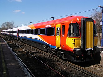 British Rail Class 442 - 442407 at Moreton in April 2006. This unit carries the revised South West Trains livery with differently coloured doors to conform with the Disability Discrimination Act.