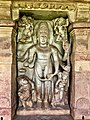 8th century Durga Surya temple Vishnu standing with chakra and conch shell, (Aivalli) Aihole Hindu temples monuments.jpg