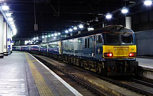 Caledonian Sleeper - 92038 at Euston in April 2015 in Serco midnight teal livery