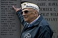 A Pearl Harbor survivor points to his name. (8264509896).jpg