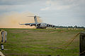 A U.S. Air Force C-17 Globemaster III aircraft assigned to Joint Base McGuire-Dix-Lakehurst, N.J., lands at the Geronimo landing zone during Joint Readiness Training Center (JRTC) 14-05 training at Fort Polk 140314-F-XL333-101.jpg