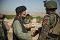 A district governor, foreground left, shakes hands with an Afghan National Army special forces soldier who is helping Afghan Local Police members build a checkpoint in Helmand province, Afghanistan, April 3 130403-M-BO337-028.jpg