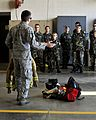 A fire protection specialist at the 182nd Civil Engineer Squadron, explains the functions of various firefighting gear to Civil Air Patrol cadets.jpg