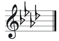 A flat major key signature on treble clef.png