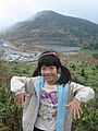 A girl sets a pose at Mount Shirane, Gunma, Japan; October 2011.jpg