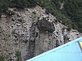A huge stone resting on small mud could fall anytime in Kalam,Swat.jpg