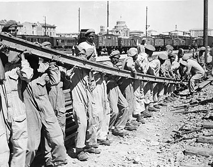 Sappers of the 136 Indian Railway Maintenance Company repairs some of the extensive damage to the railyards, 1945. A week before the German surrender in Italy, sappers of 136 Indian Railway Maintenance Company set about repairing some of the extensive damage in the railyards of Bologna, Italy.jpg
