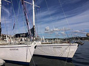 Global Challenge - Adventure and Challenger: two Challenge 72 yachts alongside in Falmouth, UK, after the transatlantic crossing from Halifax, Nova Scotia; August 2016.