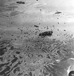 Aerial view of USS Mindanao (ARG-3) after the explosion of USS Mount Hood (AE-11) at Seeadler Harbor on 10 November 1944.jpg