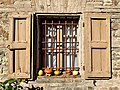 Agriturismo Cavazzone, Viano, Italy, 2019 - windows with shutters.jpg