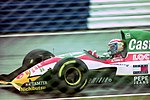 Alessandro Zanardi - Lotus 107B heads for Copse during practice for the 1993 British Grand Prix (32873595913).jpg
