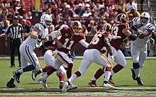dd829fe6b Washington Redskins edit . Alex Smith handing the ball ...