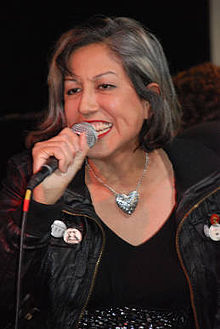 Alice Bag speaking into a microphone