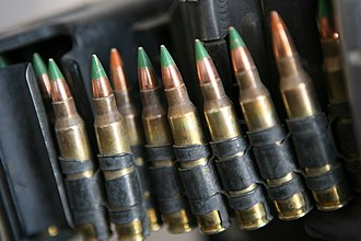 5.56×45mm NATO - M855 and M856 cartridges in an ammunition belt using M27 disintegrating links.