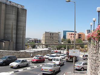 Givat Shaul - Partial view of Angel Bakeries' flour pipeline, which conveys flour directly from the flour mill to the silos (left) to the bakery (right), spanning Beit Hadfus Street in Givat Shaul.