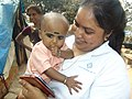 Ani - Spending some time with underprivileged child in a Slum at Bangalore.jpg