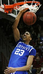 Anthony Davis dunks the ball while playing for Kentucky