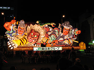 Aomori Nebuta Matsuri - A float being carried at the festival. The floats often depict historical or mythical figures.