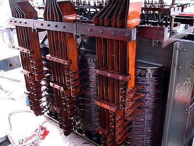 An arc furnace transformer has heavy copper bus for the low voltage winding, which can be rated tens of thousands of amperes. They are immersed in oil for cooling and insulation, and are designed to survive frequent short circuits.