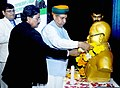 Arjun Ram Meghwal garlanding the statue of Dr. B.R. Ambedkar, at the Entrepreneurship and Vendor Development Programme for SC & ST Entrepreneurs, organised by the Indian Chambers of Commerce for Affirmative Action (ICCAA).jpg