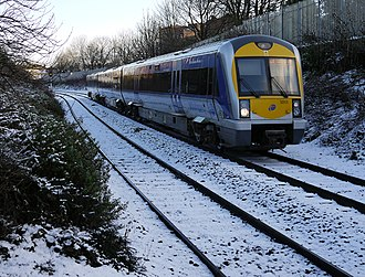 Winter of 2009–10 in Great Britain and Ireland - A train arriving at Botanic railway station on Northern Ireland Railways, on 6 January.