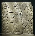 Assyrian. Relief of Eagle-Headed Winged Figure Standing Between Two Sacred Trees.jpg
