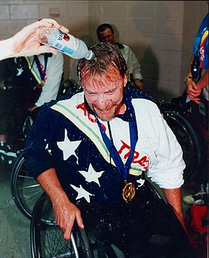 Richard Oliver (Paralympian) - Richard Oliver is sprayed with water after being presented with the gold medal at the Atlanta Paralympics