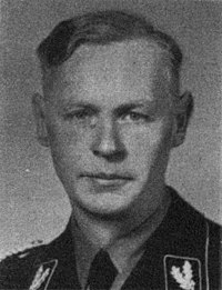 a black and white photograph of a male in uniform