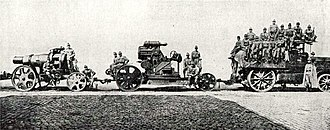 Skoda 305 mm Model 1911 - Barrel, body and crew towed by a motor tractor, circa. 1914