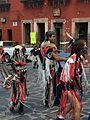 Baile de tribu con vestimenta color rojo en festejo a San Miguel de Arcángel.JPG