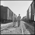 Bakersfield, California. On the Freights. Looking for an empty (freight train car) - NARA - 532071.tif