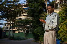 Bangalore Wikipedian on phone 2.jpg