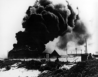 Midway Atoll - Burning oil tanks during the Battle of Midway