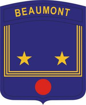 "Beaumont High School (St. Louis) - The Beaumont JROTC program shoulder sleeve insignia reflects the ""bib"" of a sailor's uniform, echoing the school mascot, while the red disc symbolizes the surgical work of William Beaumont, the school's namesake."