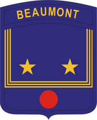 """Beaumont High School (St. Louis) - The Beaumont JROTC program shoulder sleeve insignia reflects the """"bib"""" of a sailor's uniform, echoing the school mascot, while the red disc symbolizes the surgical work of William Beaumont, the school's namesake."""