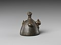 Bell with heads of a ram, a jackal, and a bovine wearing a yoke ending in uraei MET DP239488.jpg