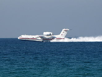 Beriev Be-200 - Beriev Be-200 filling water tanks in the Mediterranean Sea while in operation in Mount Carmel forest fire in Israel