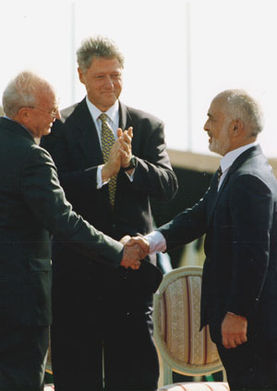 Bill Clinton, Yitzhak Rabin and King Hussein I of Jordan at the peace treaty signing ceremony.jpg