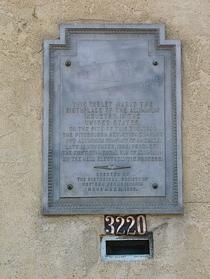 Alcoa - A tablet marking where in November 1888, the Pittsburgh Reduction Company, now Aluminum Company of America, produced the first commercial run of aluminum by the Hall Electrolytic Process. Tablet installed by Historical Society of Western Pennsylvania in 1938.
