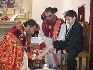 Foot washing - Bishop Sebouh Chouldjian of the Armenian Apostolic Church washing the feet of children.